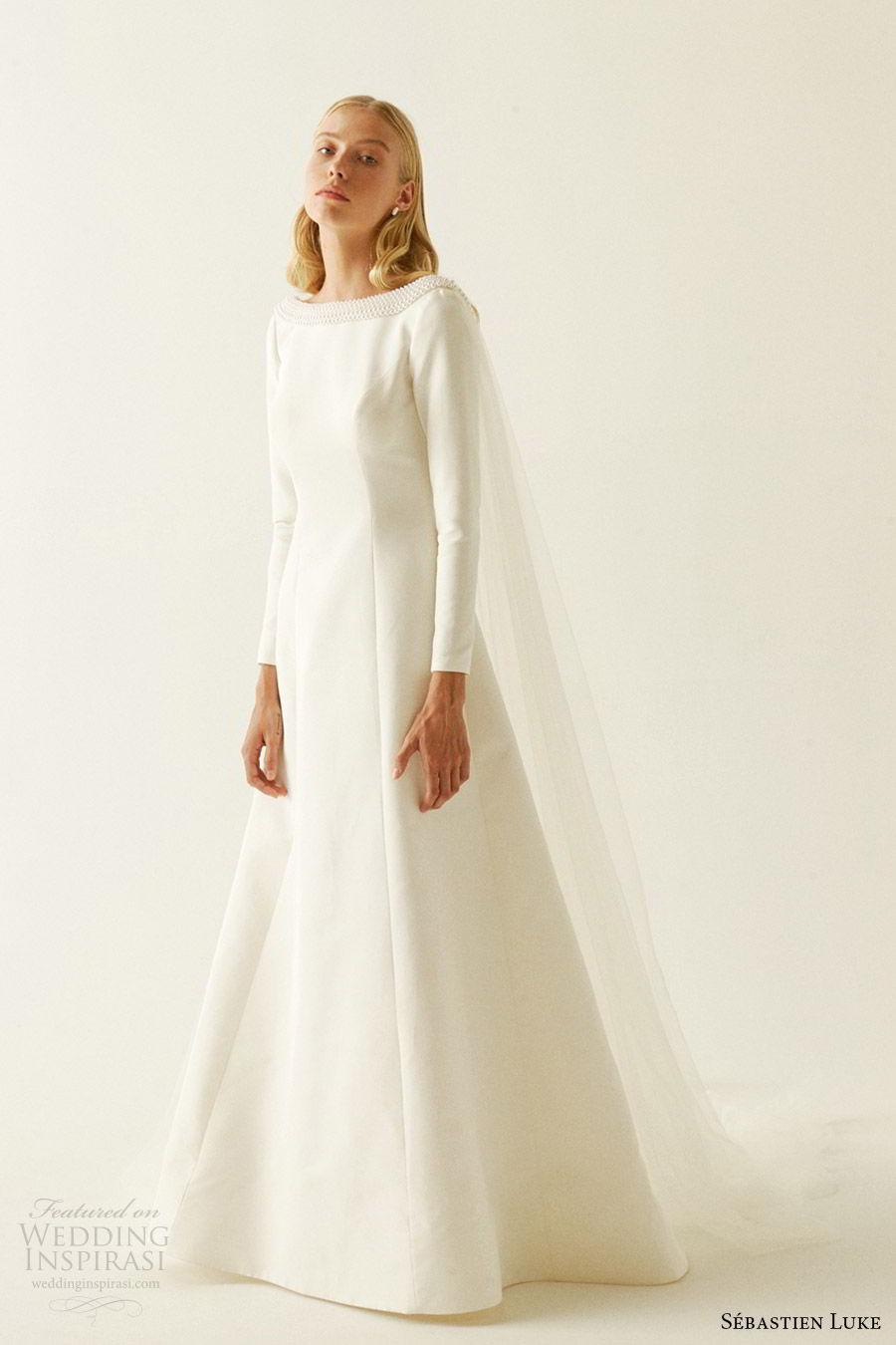 sebastien luke fall 2019 bridal jewel neckline long sleeves minimal embellishment modified a line wedding dress pockets cape clean simple modern (4) mv