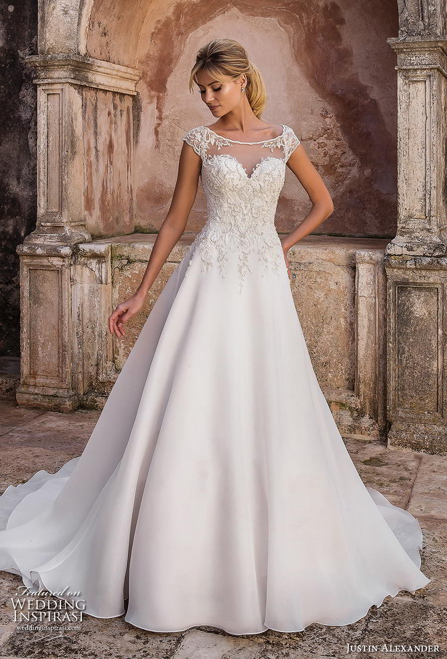 justin alexander spring 2019 bridal cap sleeves illusion bateau sweetheart neckline heavily embellished bodice classic romantic a line wedding dress sheer button back chapel train (12) mv