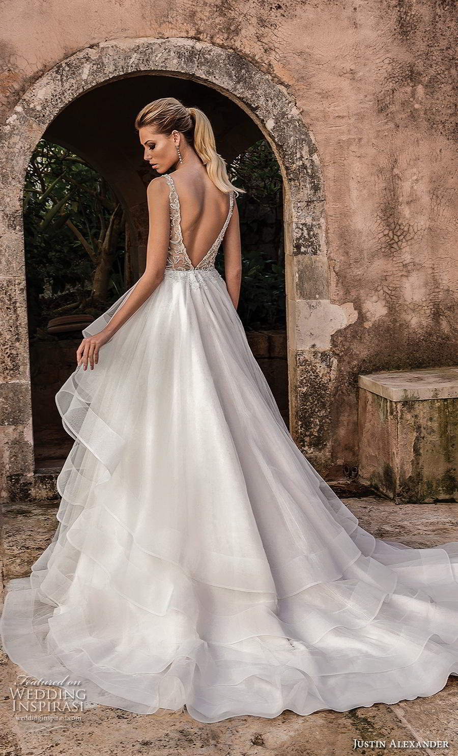 justin alexander spring 2019 bridal sleeveless with strap deep plunging v neck heavily embellished bodice tiered skirt romantic a line wedding dress backless v back chapel train (6) bv