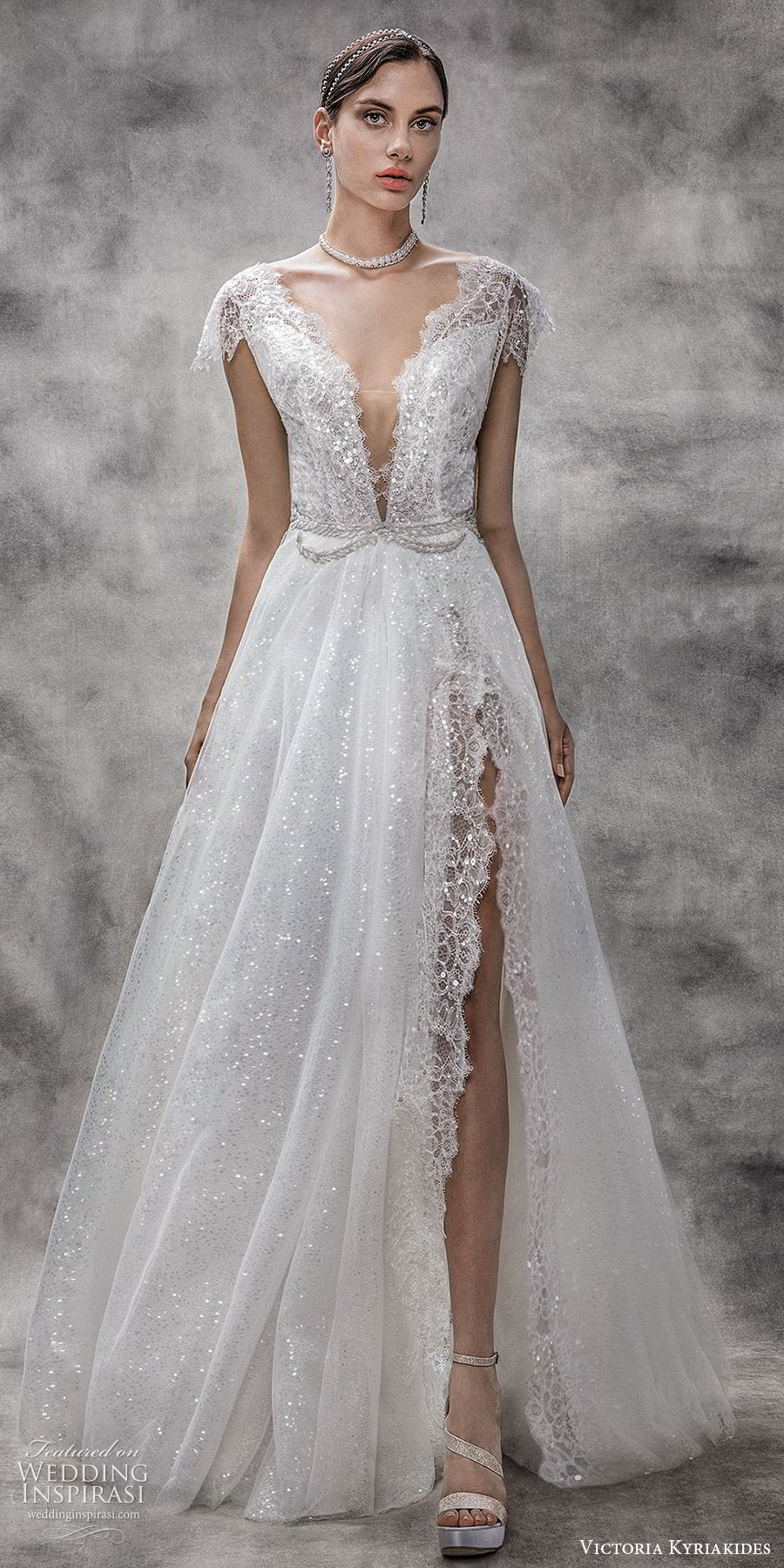 victoria kyriakides spring 2020 bridal illusion flutter sleeves deep v neckline fully embellished lace a line ball gown wedding dress (10) chapel train slit skirt glitzy romantic mv