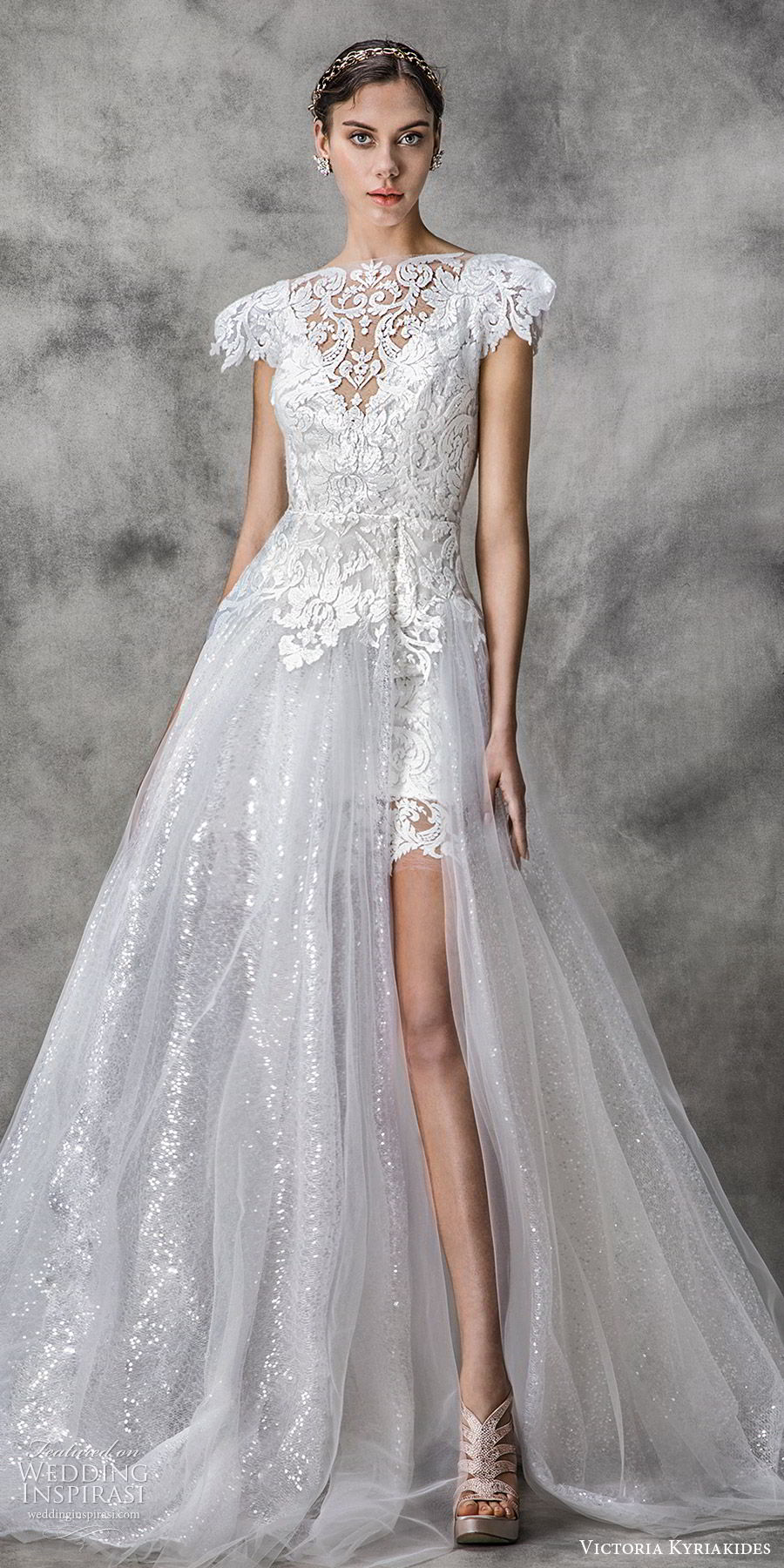 victoria kyriakides spring 2020 bridal short puff sleeves bateau neckline slit skirt fully embellished lace a line ball gown wedding dress (5) chapel train modern romantic mv