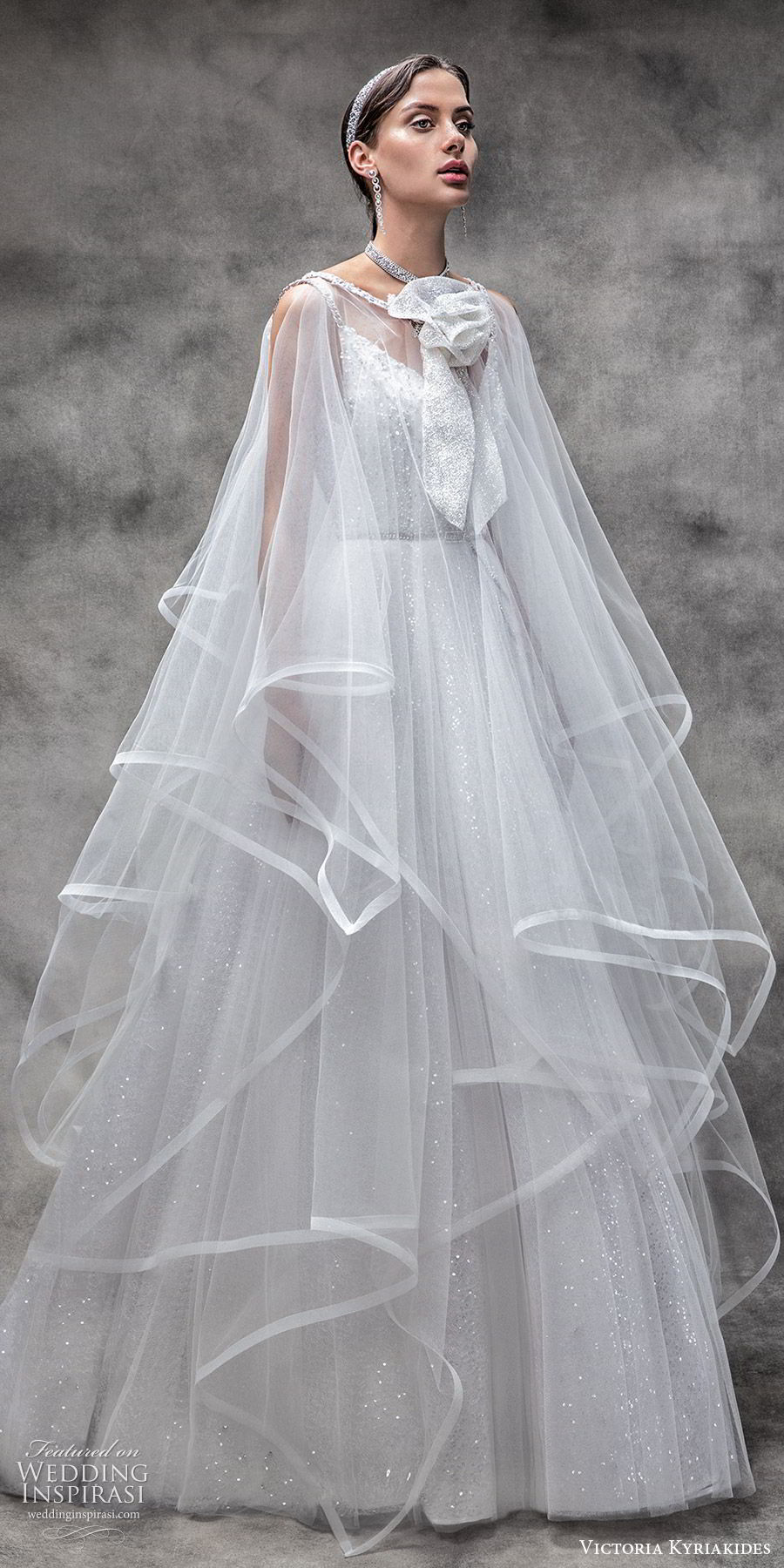 victoria kyriakides spring 2020 bridal sleeveless beaded straps v neck fully embellished a line ball gown wedding dress (11) glitzy romantic sheer cape overskirt mv