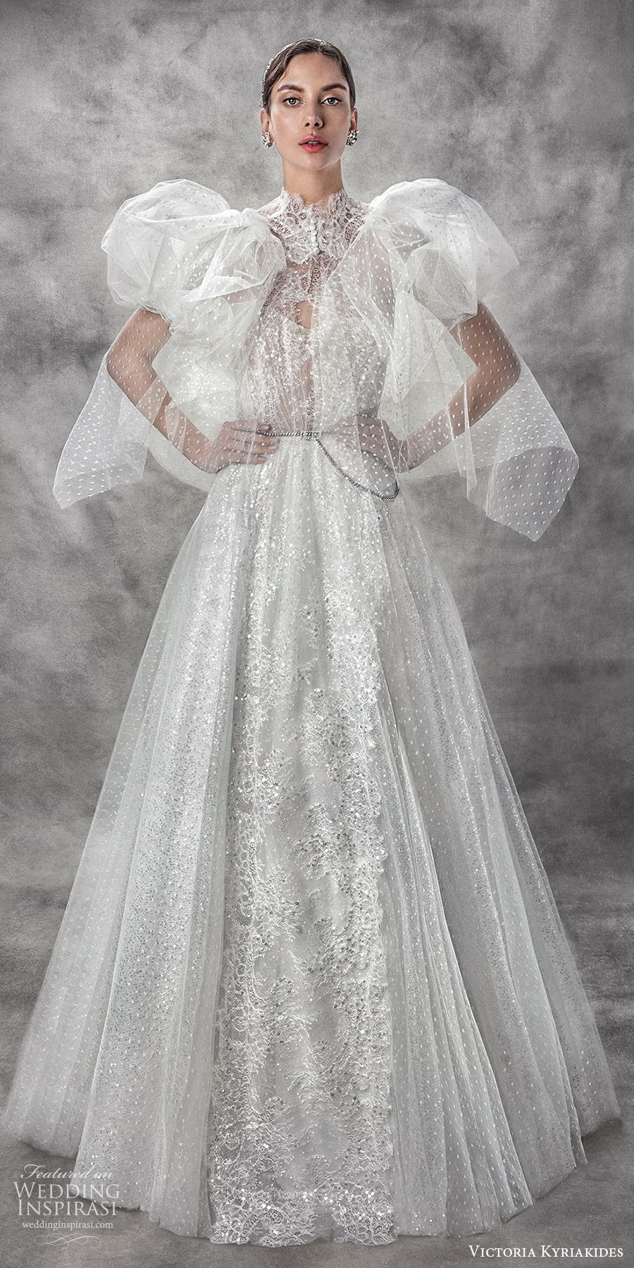 victoria kyriakides spring 2020 bridal sleeveless halter neck sheer bodice sweetheart fully embellished a line ball gown wedding dress (3) sheer puff sleeve cape glitzy romantic mv