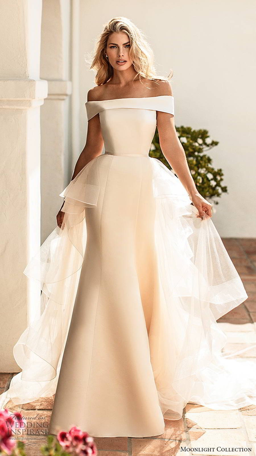 moonlight collection spring 2020 bridal off shoulder short sleeves straight across neckline tiered a line overskirt clean minimalist fit flare mermaid wedding dress v back chapel train (8) mv