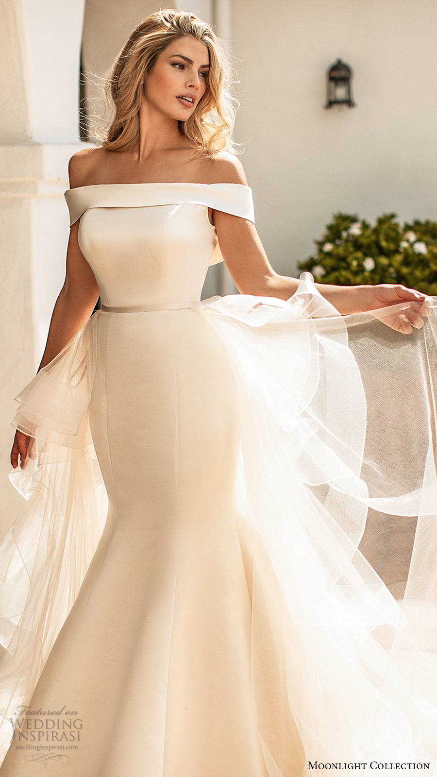 moonlight collection spring 2020 bridal off shoulder short sleeves straight across neckline tiered a line overskirt clean minimalist fit flare mermaid wedding dress v back chapel train (8) zv