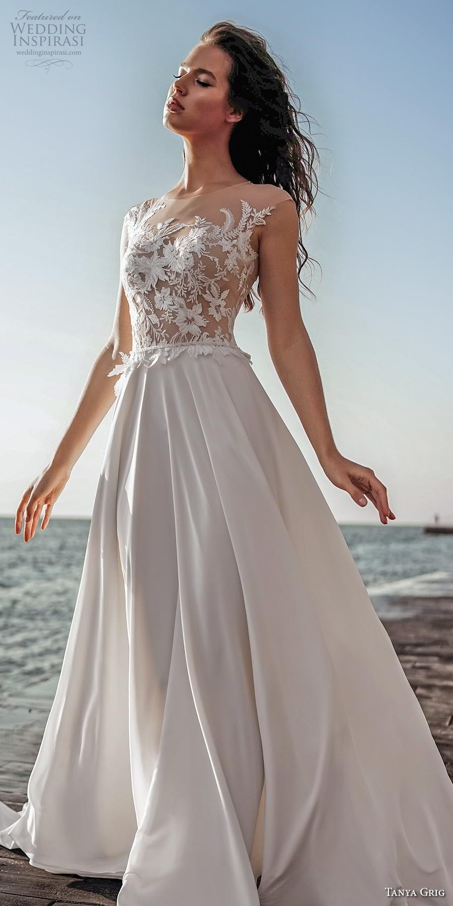 tanya grig 2020 bridal sleeveless illusion bateau heavily embellished bodice romantic soft a  line wedding dress sheer button back chapel train (9) lv