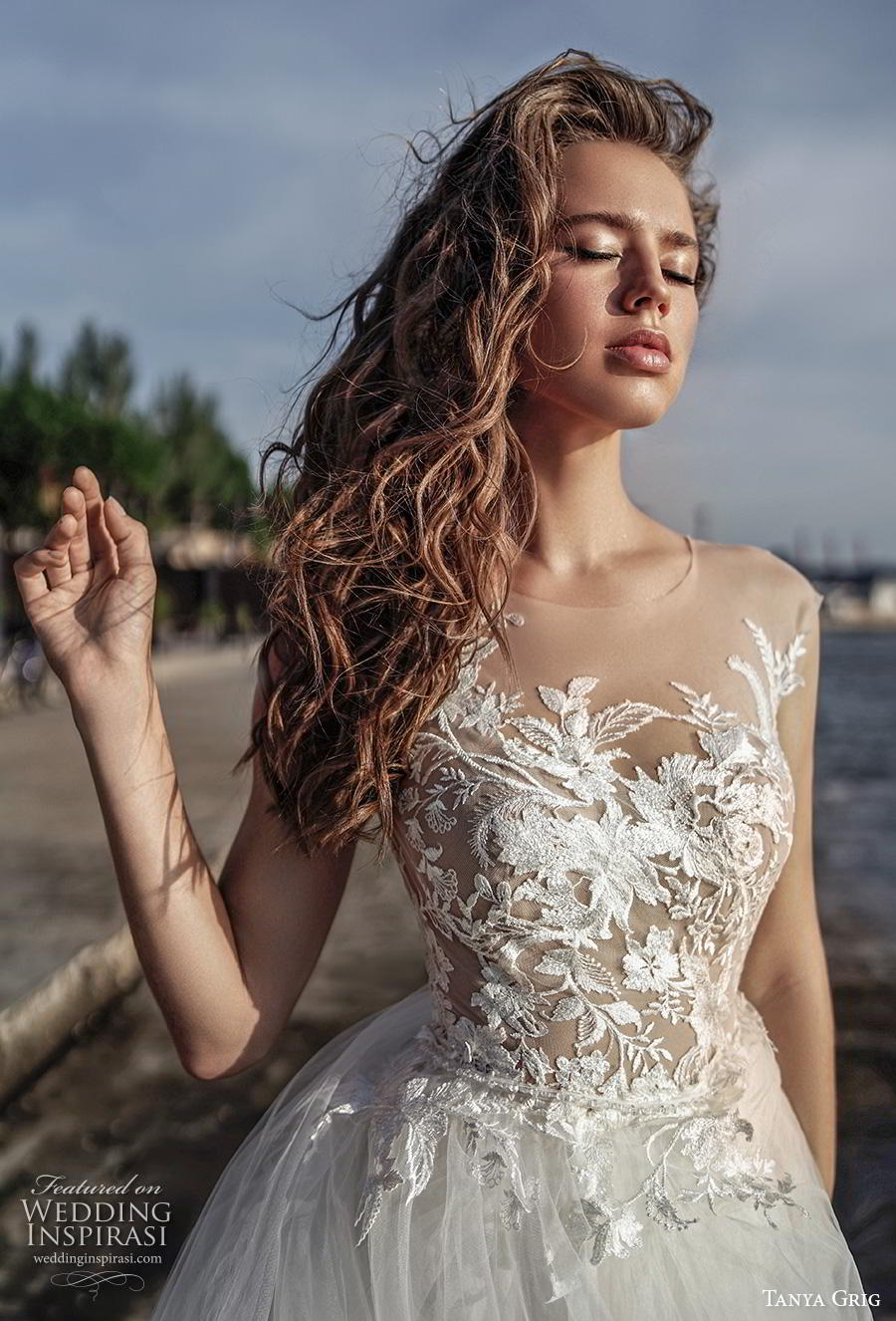 tanya grig 2020 bridal sleeveless illusion bateau heavily embellished bodice romantic soft a  line wedding dress sheer button back chapel train (9) zv