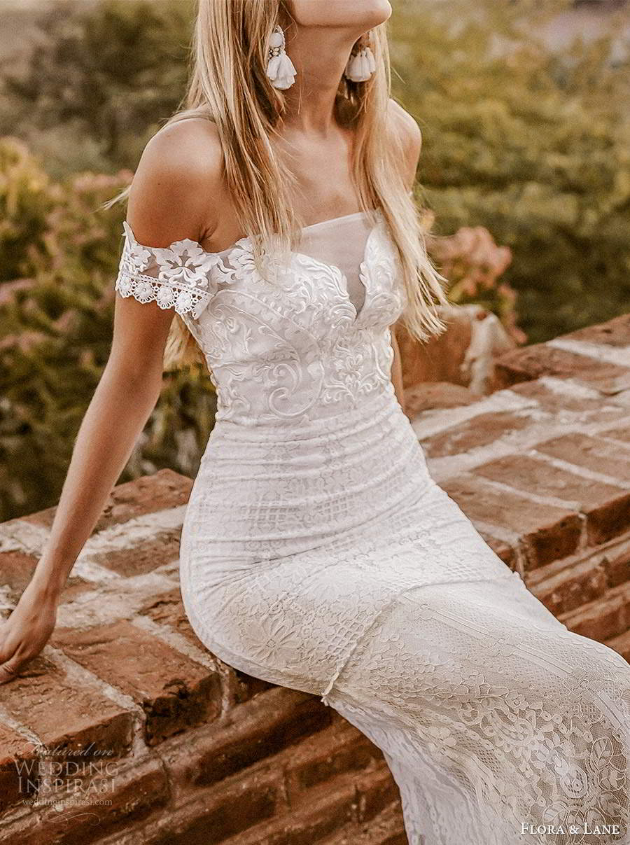 flora and lane 2019 bridal off shoulder short sleeves straight across neckline fully embellished lace sheath mermaid wedding dress sheer back chapel train (2) mv