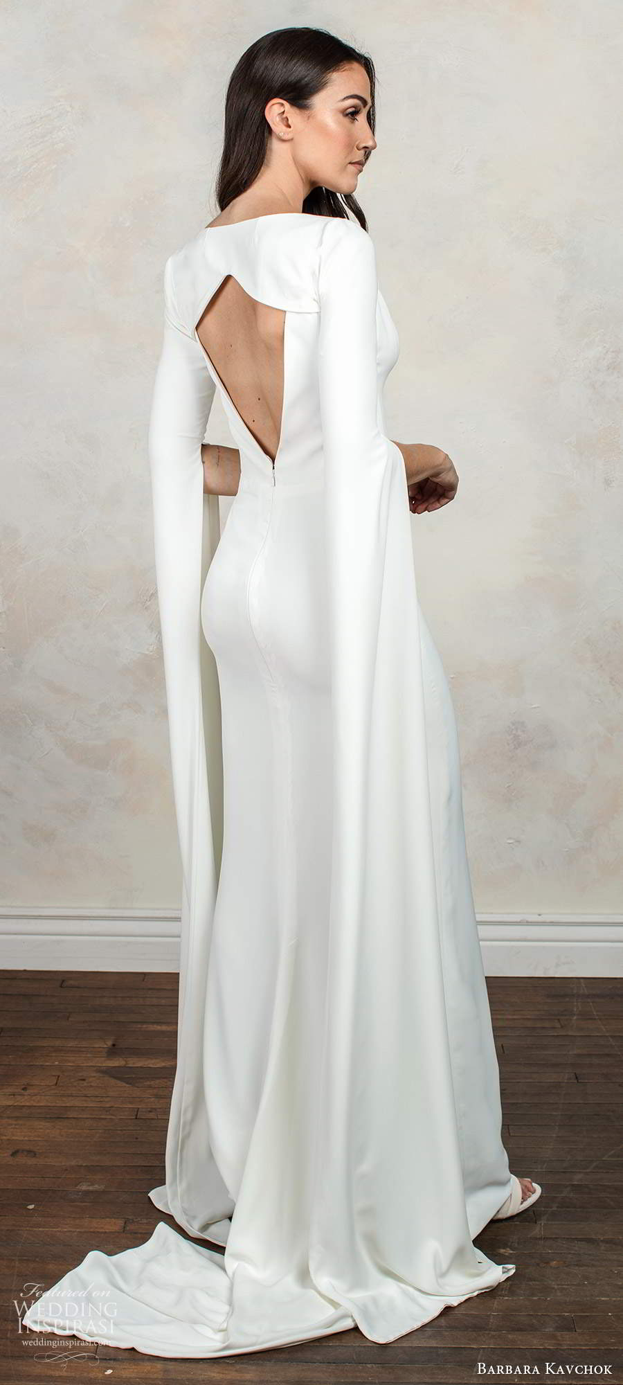 barbara kavchok fall 2020 bridal sleeveless v neckline clean minimally embellished sheath wedding dress keyhole back chapel train long sleeve capelet (3) bv