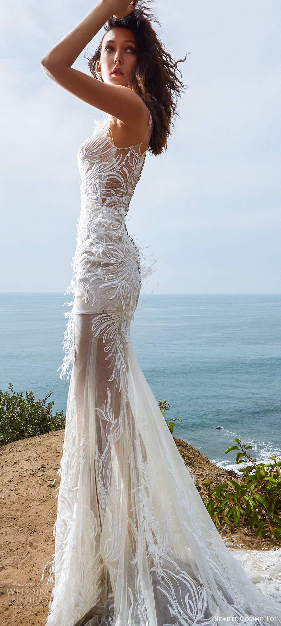 beaute comme toi f2020 bridal feather one shoulder sleeves illusion neckline full embellishment elegant glamorous fit and flare sheath wedding dress lace button back medium train (8) sv