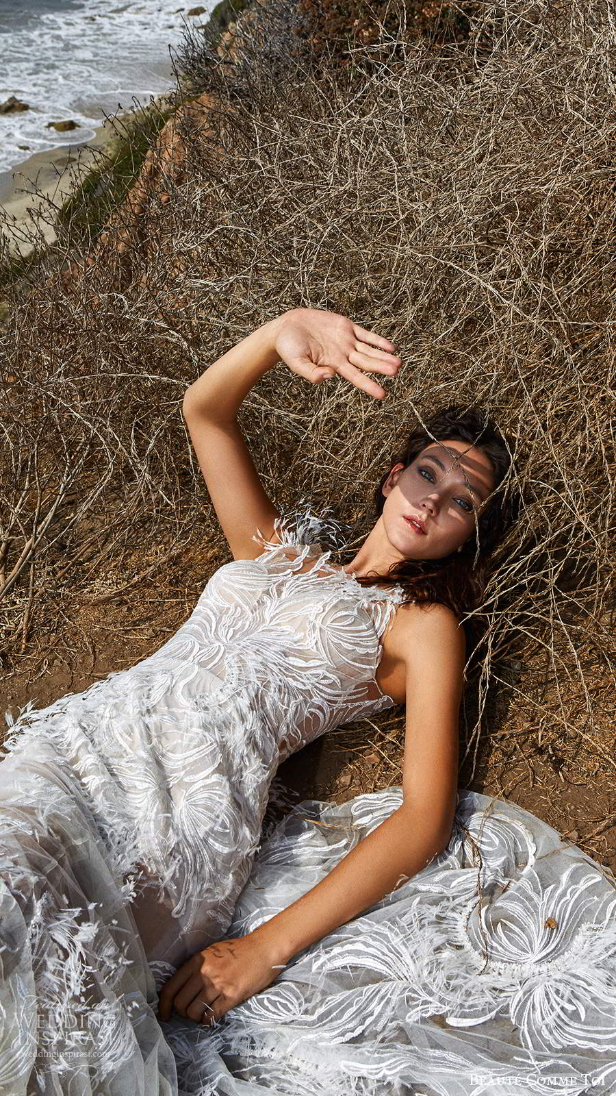 beaute comme toi f2020 bridal feather one shoulder sleeves illusion neckline full embellishment elegant glamorous fit and flare sheath wedding dress lace button back medium train (8) zv
