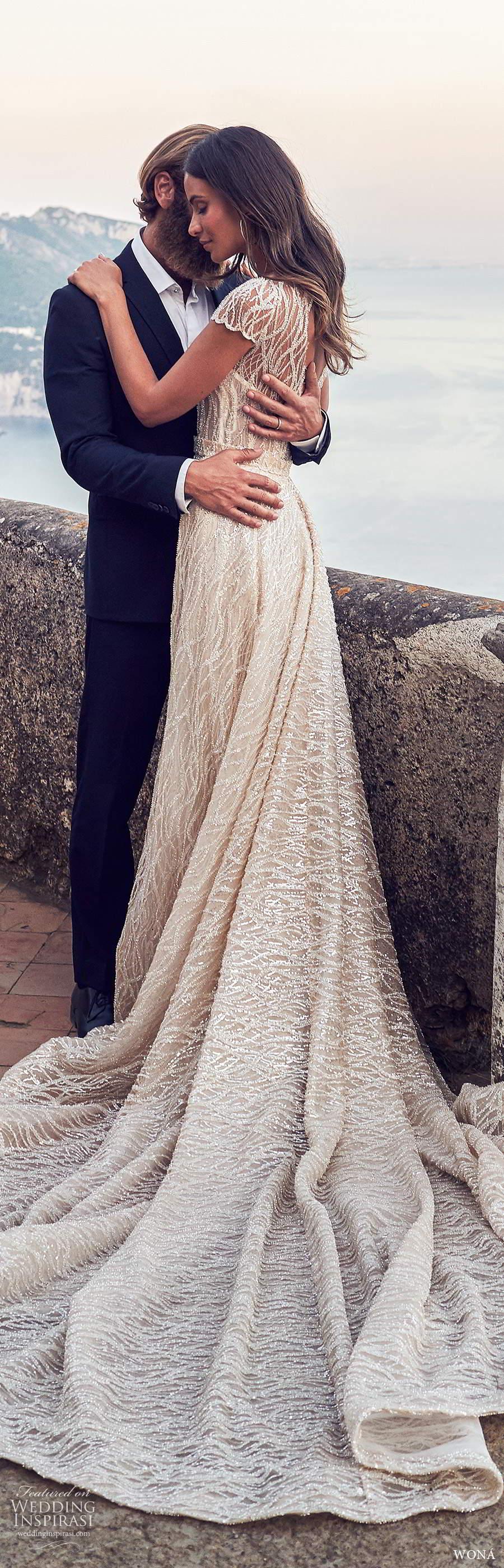 wona fall 2020 bridal illusion cap sleeves sheer bateau neckline fully embellished glitzy sheath wedding dress a line overskirt chapel train (20) bv