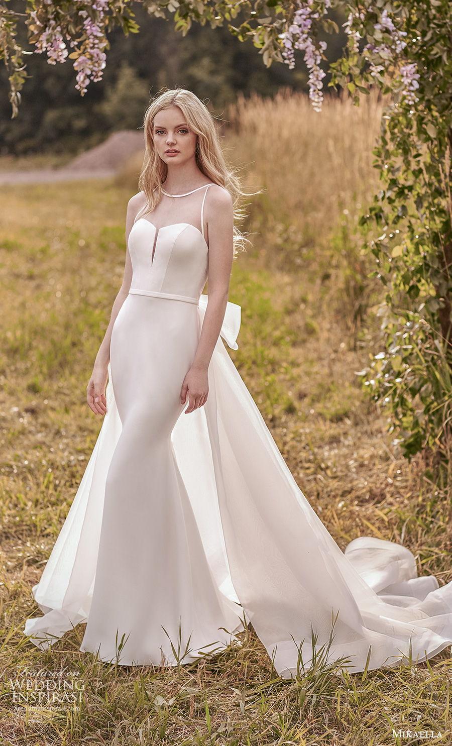 mikaella spring 2020 bridal sleeveless illusion bateau sweetheart neckline simple minimalist elegant fit and flare wedding dress a  line overskirt sheer keyhole back chapel train (1) mv