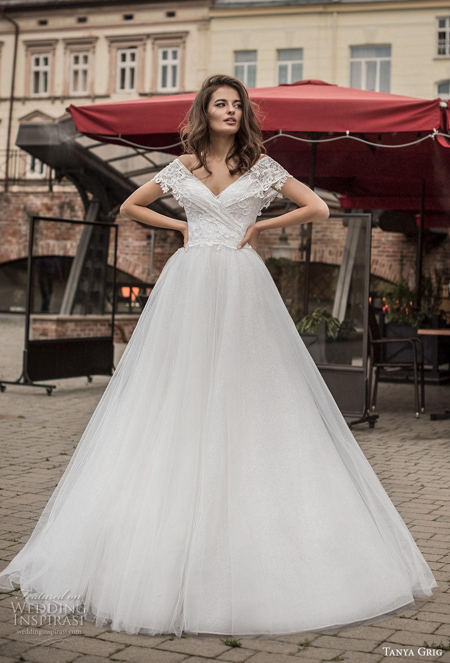 tanya grig 2021 bridal off the shoulder short sleeves v neck wrap over heavily embellished bodice romantic a  line wedding dress v back chapel train (9) mv