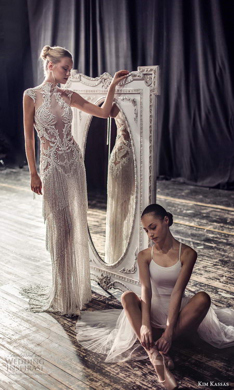 kim kassas fall 2021 bridal cap sleeves high neckline fully embellished column wedding dress tiered fringe skirt (10) mv