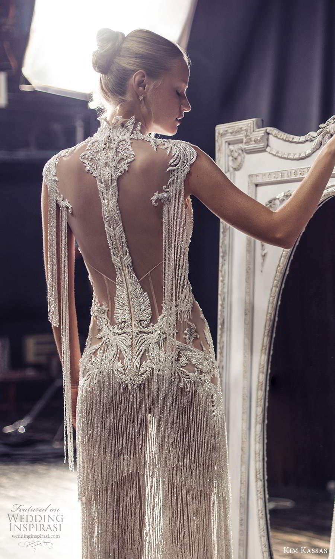 kim kassas fall 2021 bridal cap sleeves high neckline fully embellished column wedding dress tiered fringe skirt sheer beaded back (10) mv