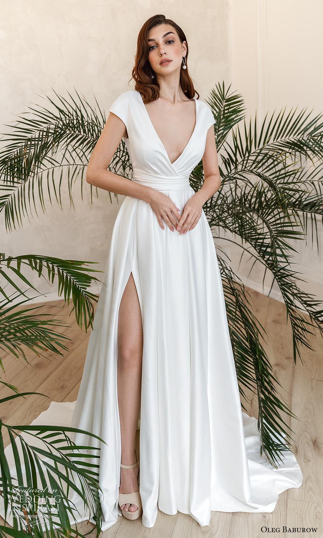 oleg baburow fall 2021 bridal cap sleeves plunging surplice v neckline clean minimalist a line wedding dress slit skirt chapel train (10) mv