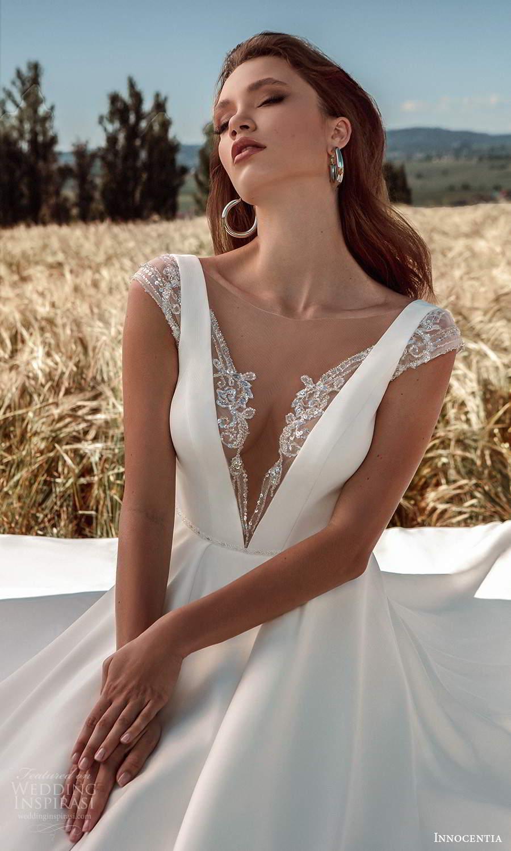 innocentia 2021 harmonia bridal cap sleeves illusion bateau plunging v neckline clean minimalist a line ball gown wedding dress chapel train (11) zv