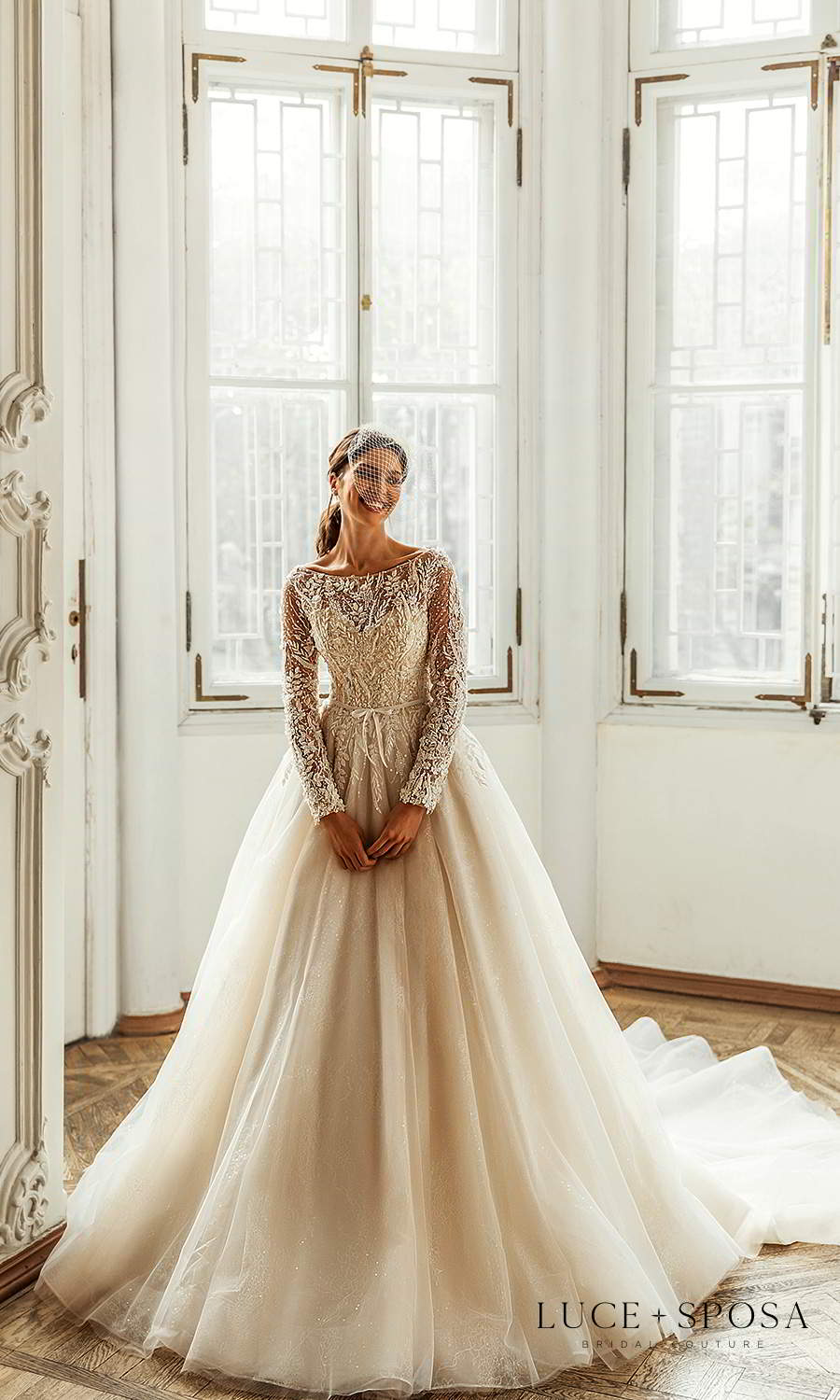 luce sposa 2021 shades of couture bridal long sleeve bateau neckline heavily embellished bodice a line ball gown wedding dress cathedral train champagne (charlotte) mv