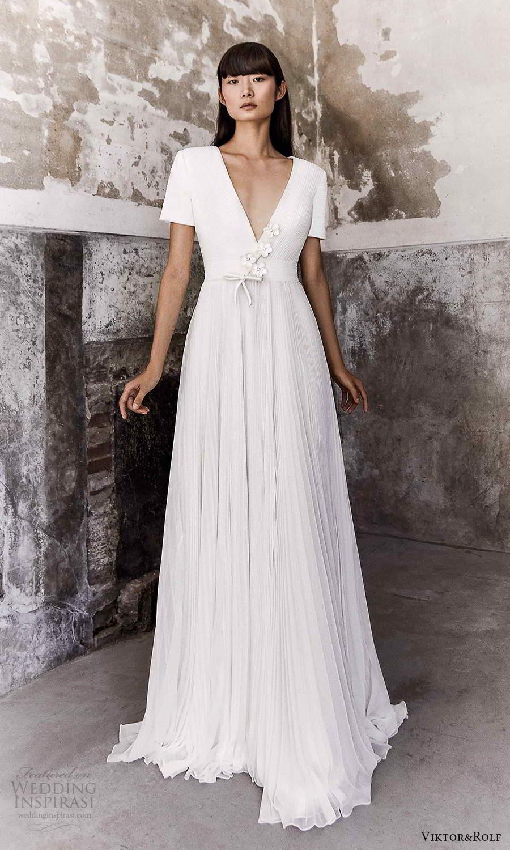 viktor and rolf fall 2021 bridal short sleeve v neckline clean minimalist a line ball gown wedding dress pleated skirt chapel train (18) mv