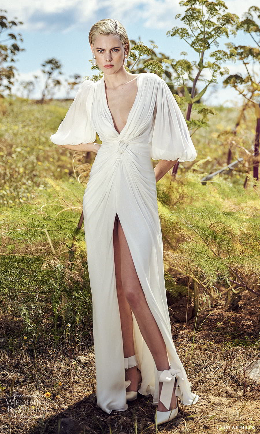 costarellos spring 2022 bridal elbow length puff sleeves plunging v neckline ruched bodice column wedding dress sweep train slit skirt (4) mv