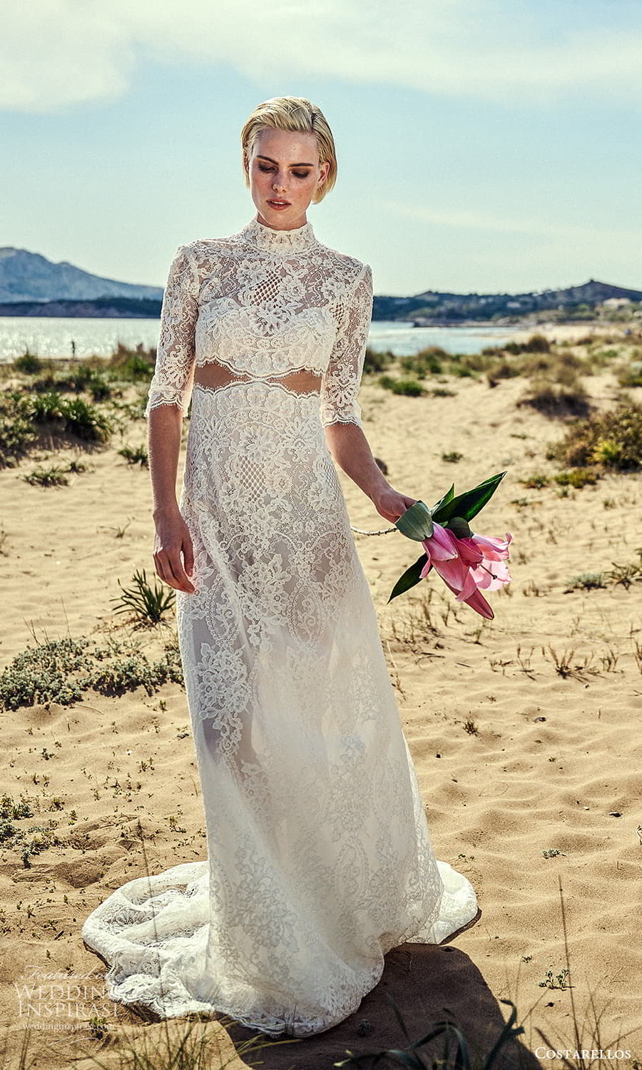 costarellos spring 2022 bridal elbow length sleeves high neckline fully embellished lace sheath wedding dress chapel train (20) mv