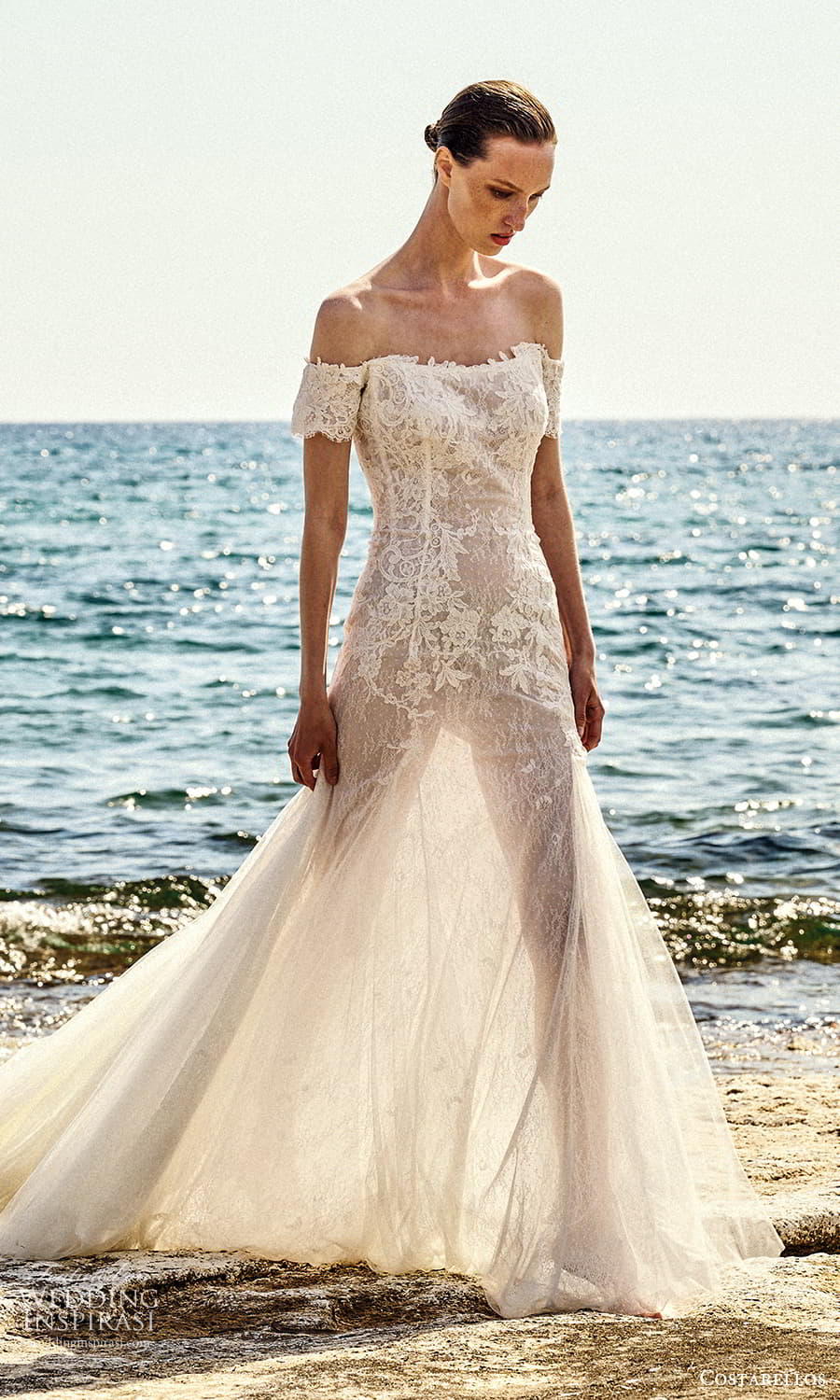 costarellos spring 2022 bridal off shoulder short sleeves straight across neckline fully embellished lace fit flare mermaid wedding dress chapel train (2) mv
