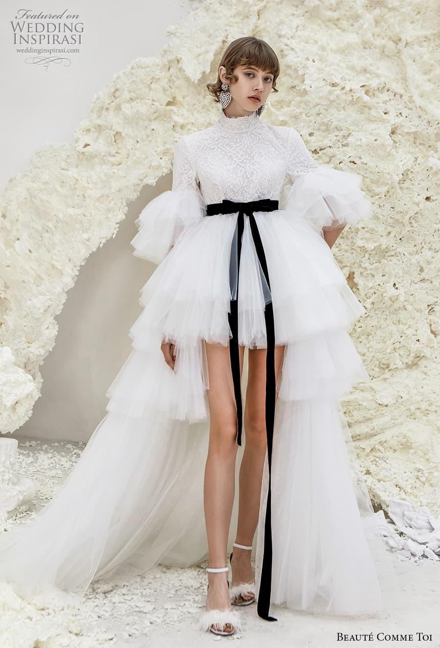 beaute comme toi spring 2022 bridal half poet sleeves high neck heavily embellished bodice short wedding dress a line overskirt covered lace back chapel train (karrisa) mv