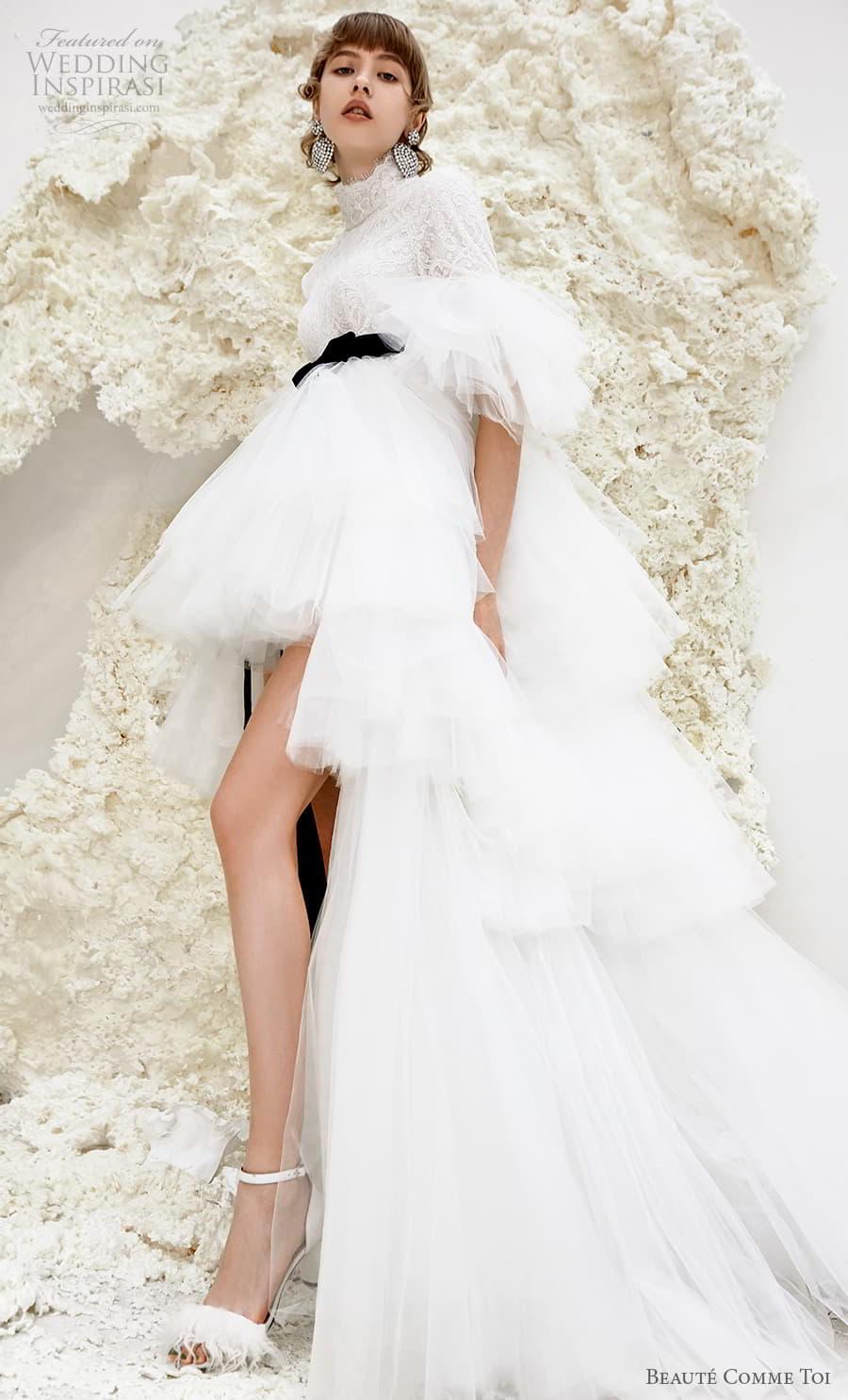 beaute comme toi spring 2022 bridal half poet sleeves high neck heavily embellished bodice short wedding dress a line overskirt covered lace back chapel train (karrisa) sv
