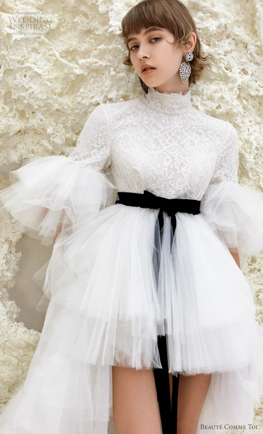 beaute comme toi spring 2022 bridal half poet sleeves high neck heavily embellished bodice short wedding dress a line overskirt covered lace back chapel train (karrisa) zv
