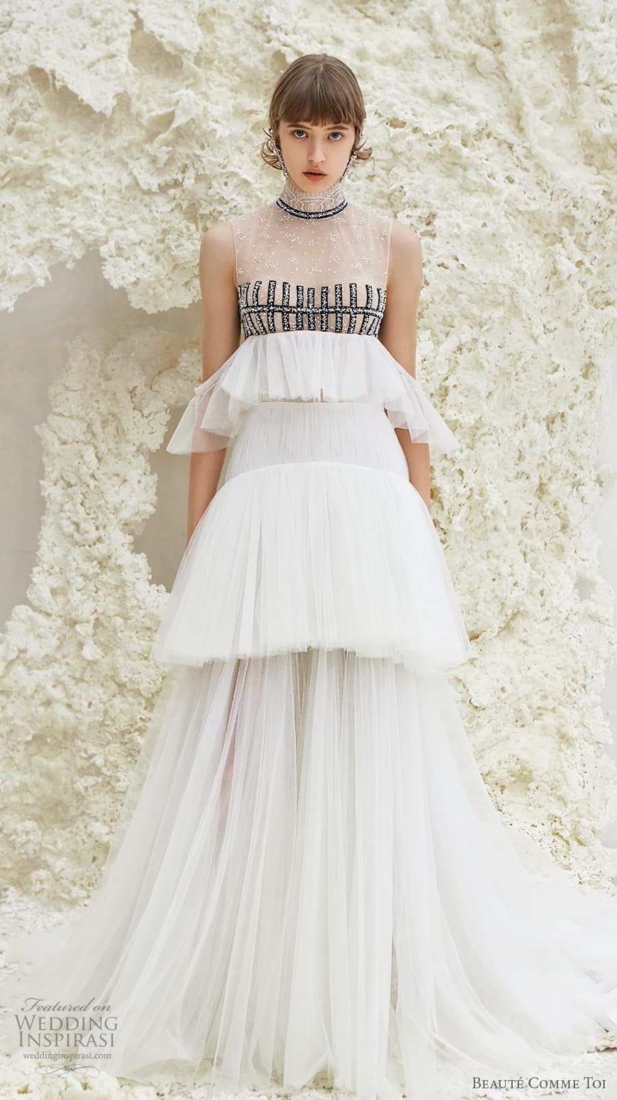 beaute comme toi spring 2022 bridal sleeveless high neck lightly embellished bodice empire a line wedding dress sheer button back tiered skirt sweep train (faye) mv