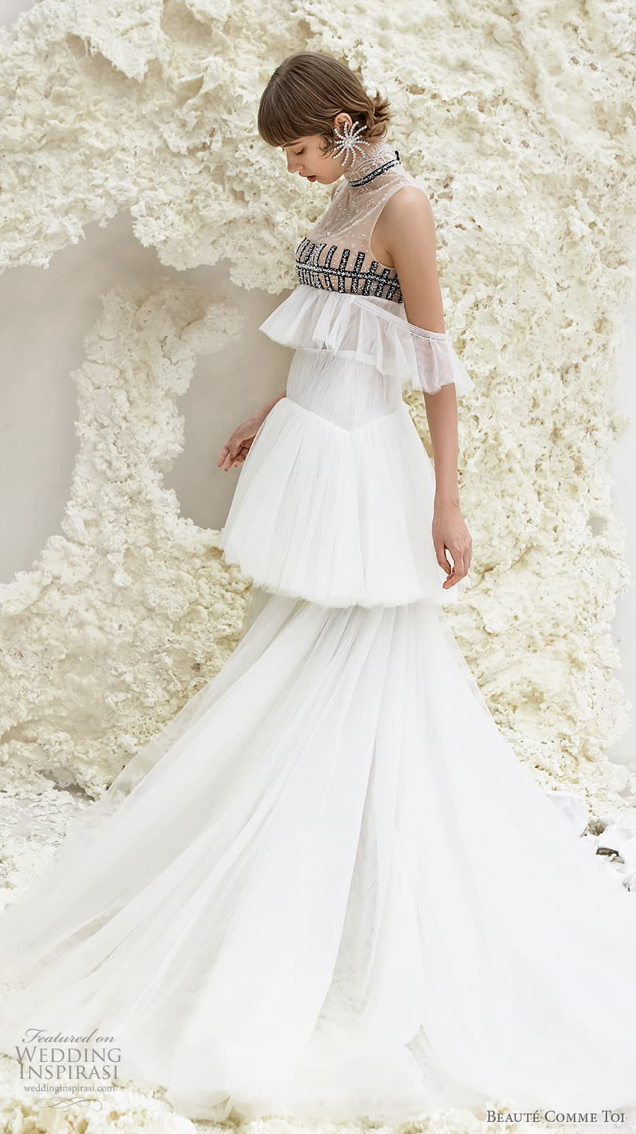 beaute comme toi spring 2022 bridal sleeveless high neck lightly embellished bodice empire a line wedding dress sheer button back tiered skirt sweep train (faye) sv