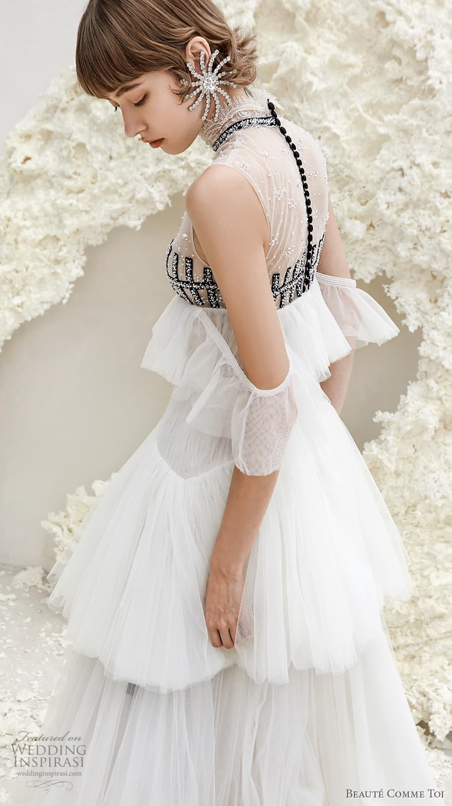 beaute comme toi spring 2022 bridal sleeveless high neck lightly embellished bodice empire a line wedding dress sheer button back tiered skirt sweep train (faye) zbv