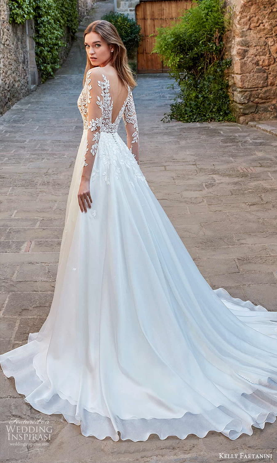 kelly faetanini spring 2022 campaign bridal sheer long sleeve plunging v neckline embellished lace a line ball gown wedding dress chapel train (19) bv