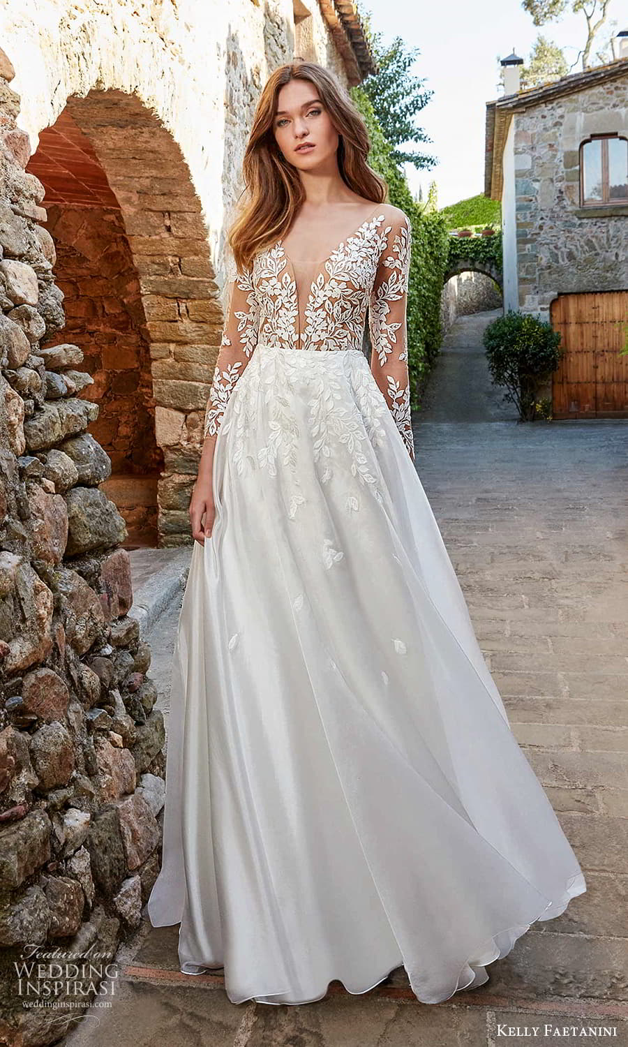 kelly faetanini spring 2022 campaign bridal sheer long sleeve plunging v neckline embellished lace a line ball gown wedding dress chapel train (19) mv
