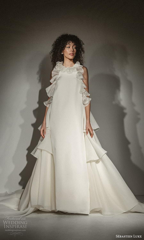 sebastien luke fall 2021 bridal sleeveless jewel neckline ruffle embellished clean minimalist a line wedding dress chapel train (9) mv