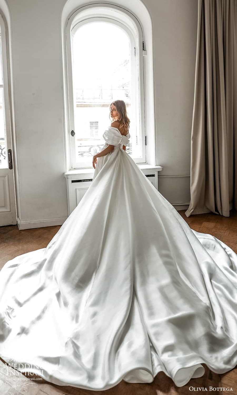 olivia bottega 2022 capsule bridal elbow length sleeve off shoulder neckline ruched bodice clean minimalist sheath wedding dress a line overskirt cathedral chapel train (7) bv