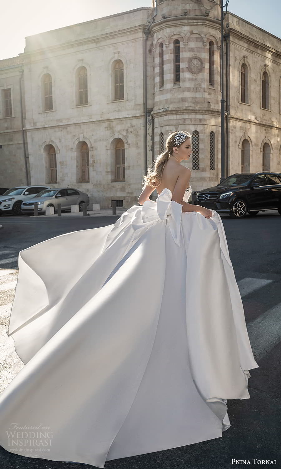pnina tornai 2022 love bridal strapless embellished sweetheart neckline ruched bodice minimalist a line ball gown wedding dress chapel train bow back (3) bv
