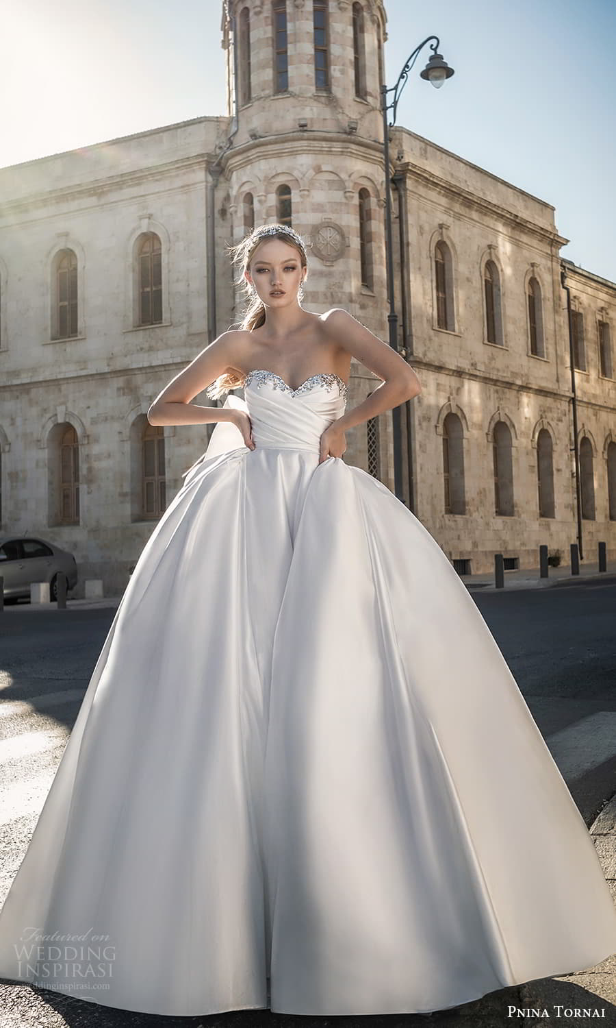 pnina tornai 2022 love bridal strapless embellished sweetheart neckline ruched bodice minimalist a line ball gown wedding dress chapel train bow back (3) mv